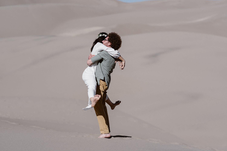 Bride and Groom hugging at Colorado Great Sand Dunes Elopement