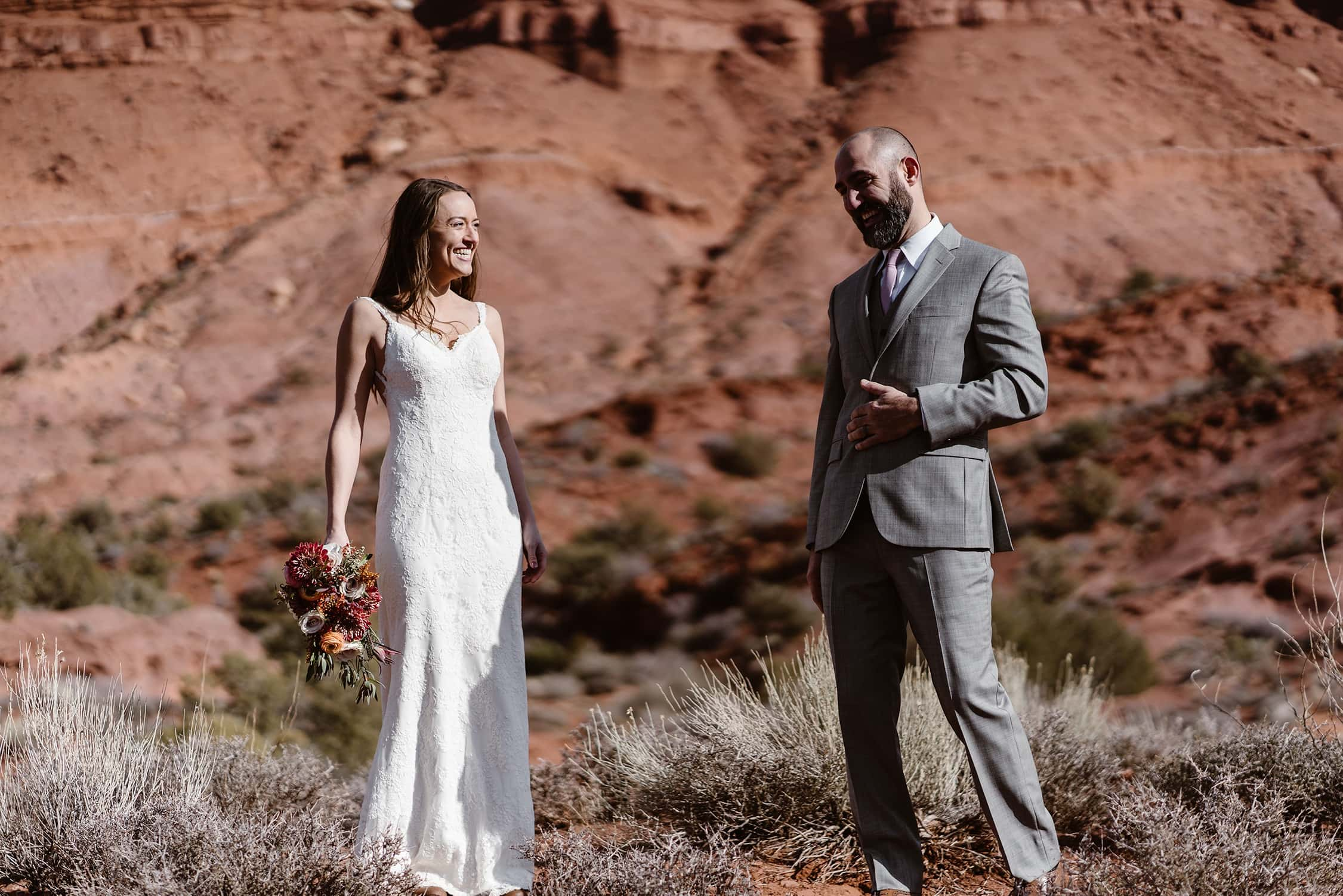Bride and Groom Laughing at Moab Elopement
