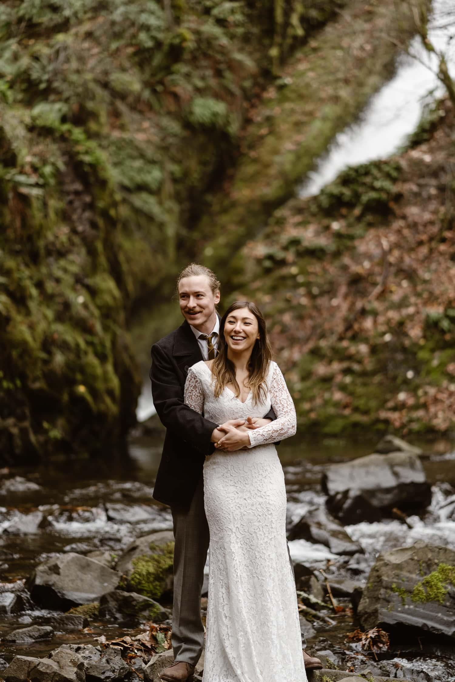 Bride and Groom Hugging Oregon Adventurous Waterfall elopement