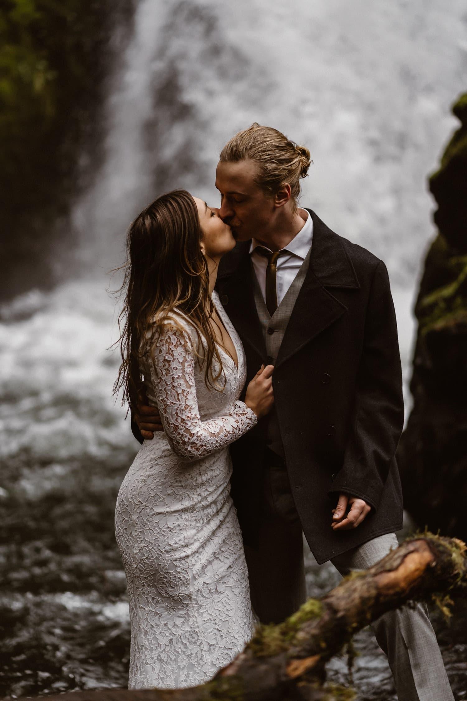 Bride and Groom Kissing at Oregon Adventurous Waterfall elopement
