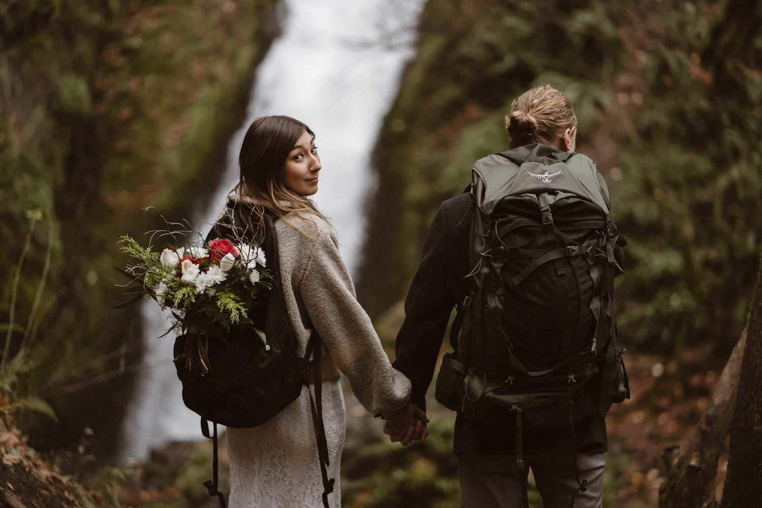 Husband and wife backpacking in Oregon elopement Location