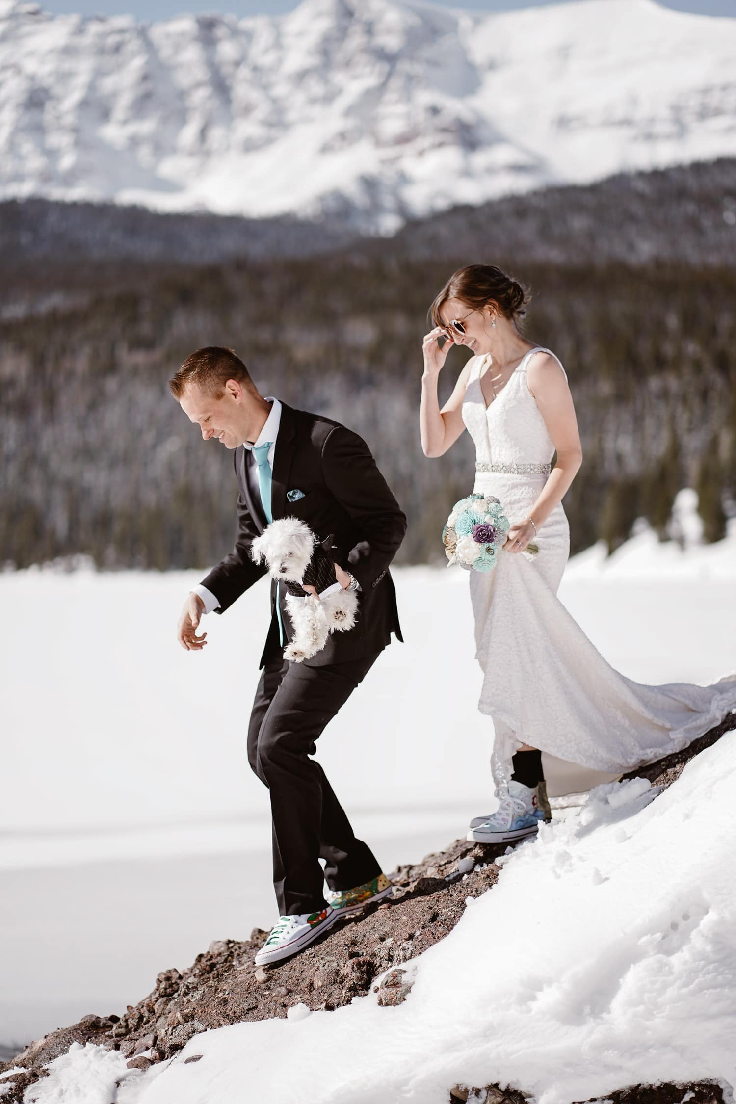 Bride and Groom Hiking Down Rock at Telluride Elopement