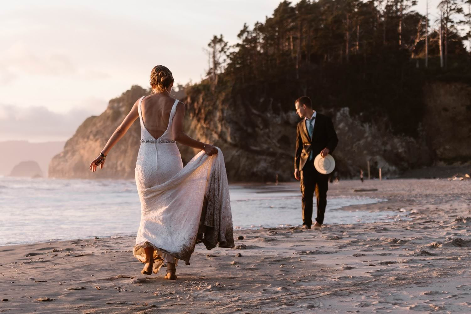 Bride and Groom playing frisbee at Hug Point & Cannon Beach Elopement