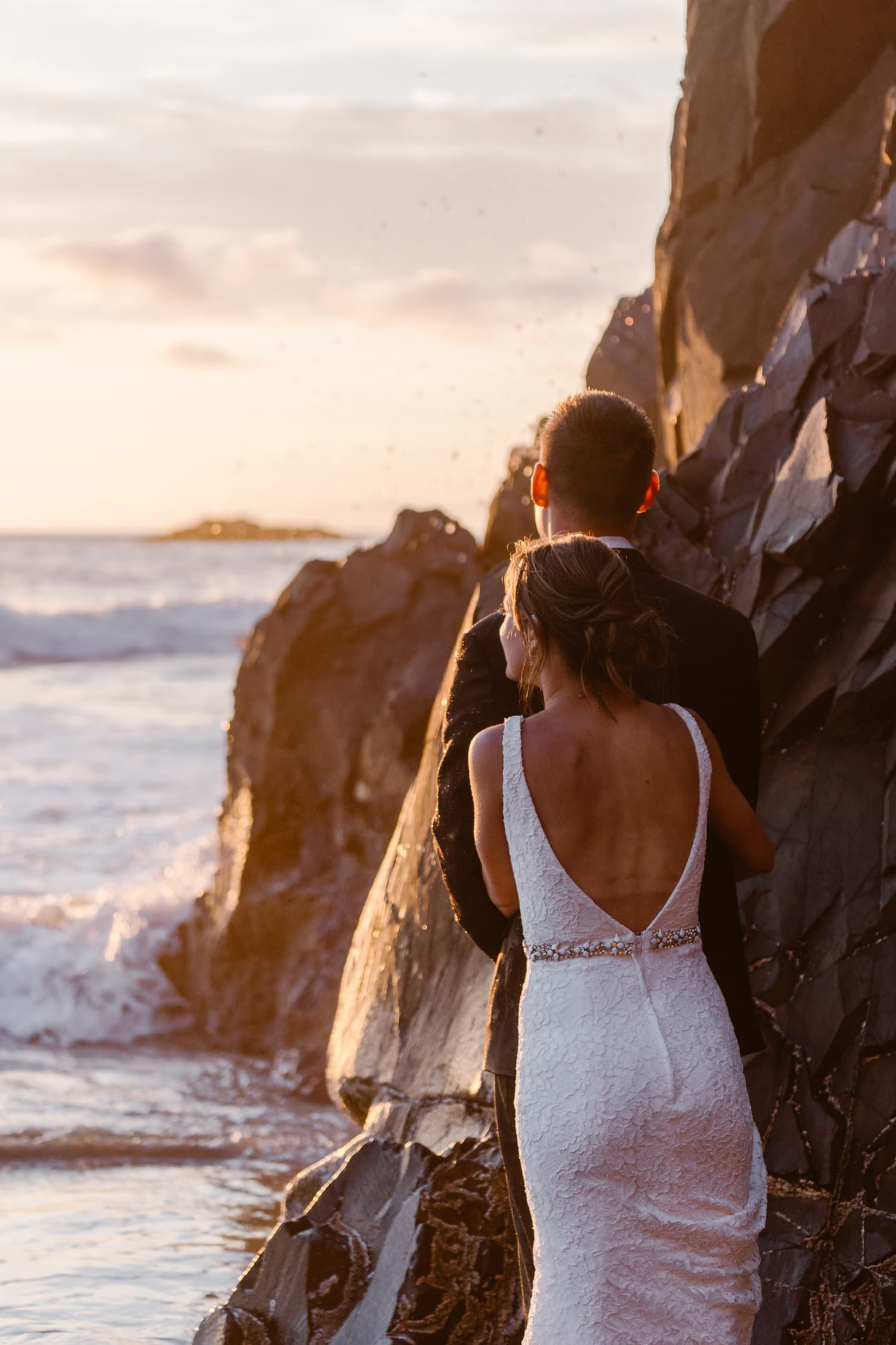 Bride and Groom in ocean at sunset at Hug Point & Cannon Beach Elopement