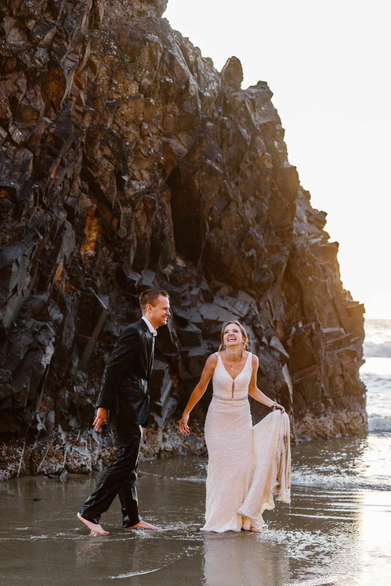 Bride and Groom soaked in ocean water at Hug Point & Cannon Beach Elopement
