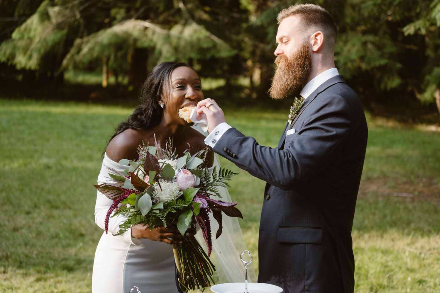 Bride and Groom Eating Donuts at Olympic National Park Elopement Ceremony