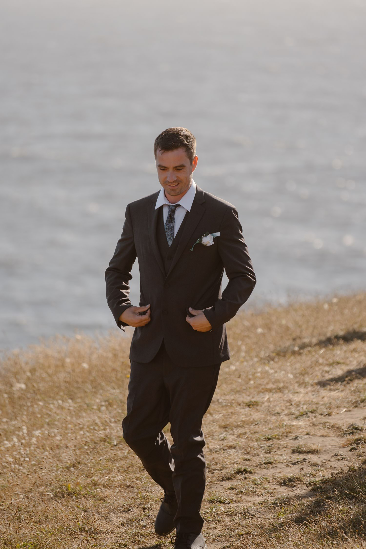 Groom at first look in Big Sur Elopement