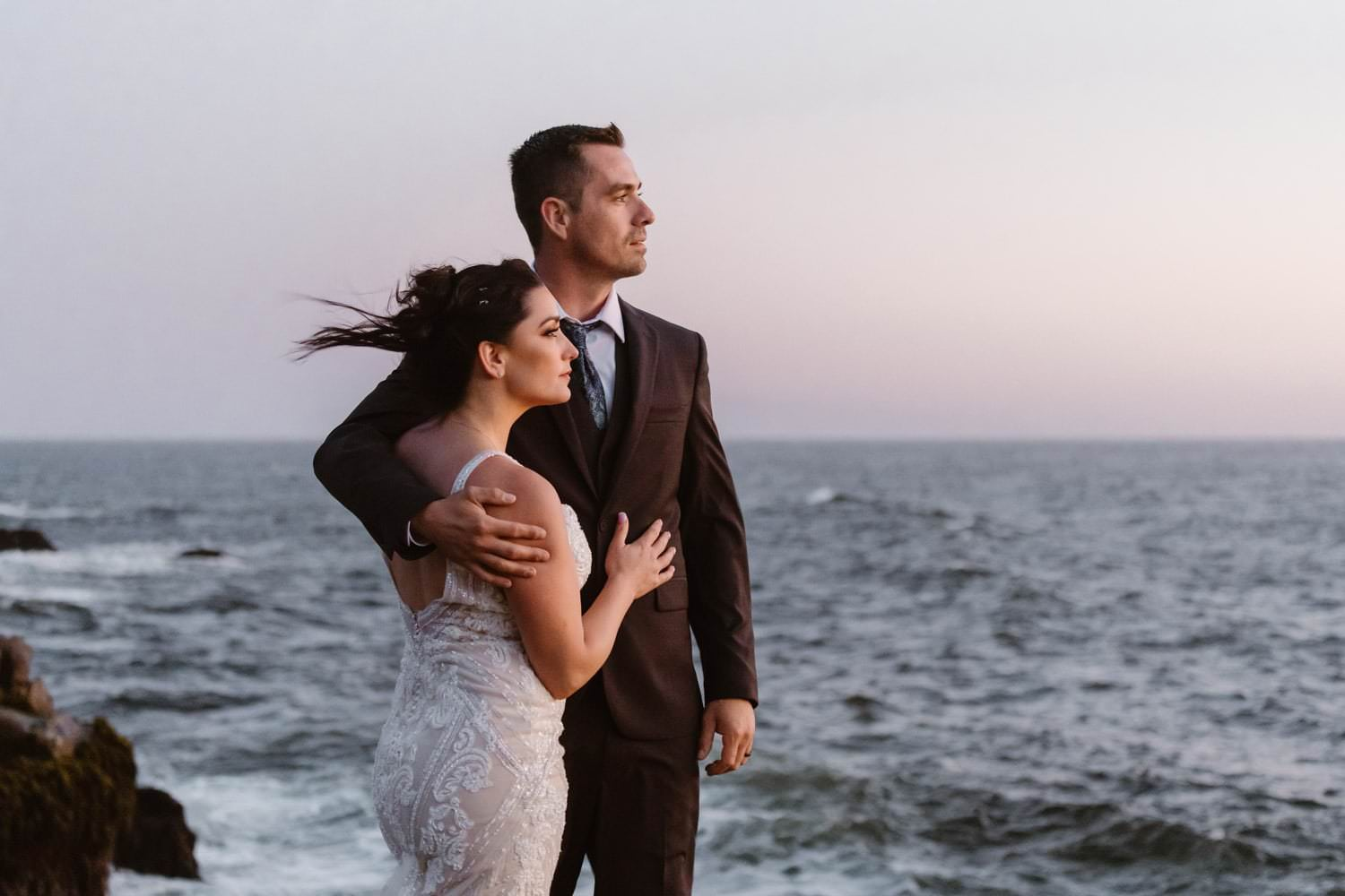 Bride and Groom posing near ocean at Big Sur Elopement
