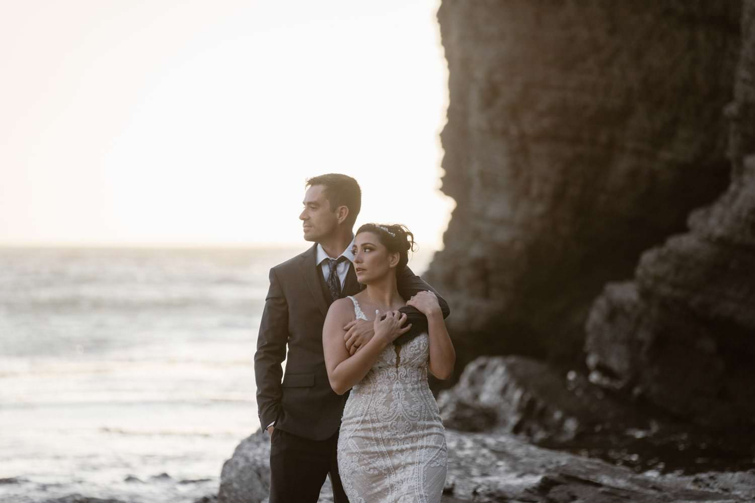 Bride and groom posing at sunset at Big Sur Elopement