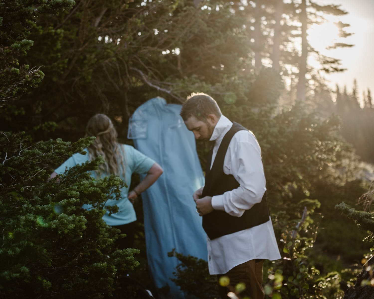 Bride and Groom changing at Colorado Adventure Elopement