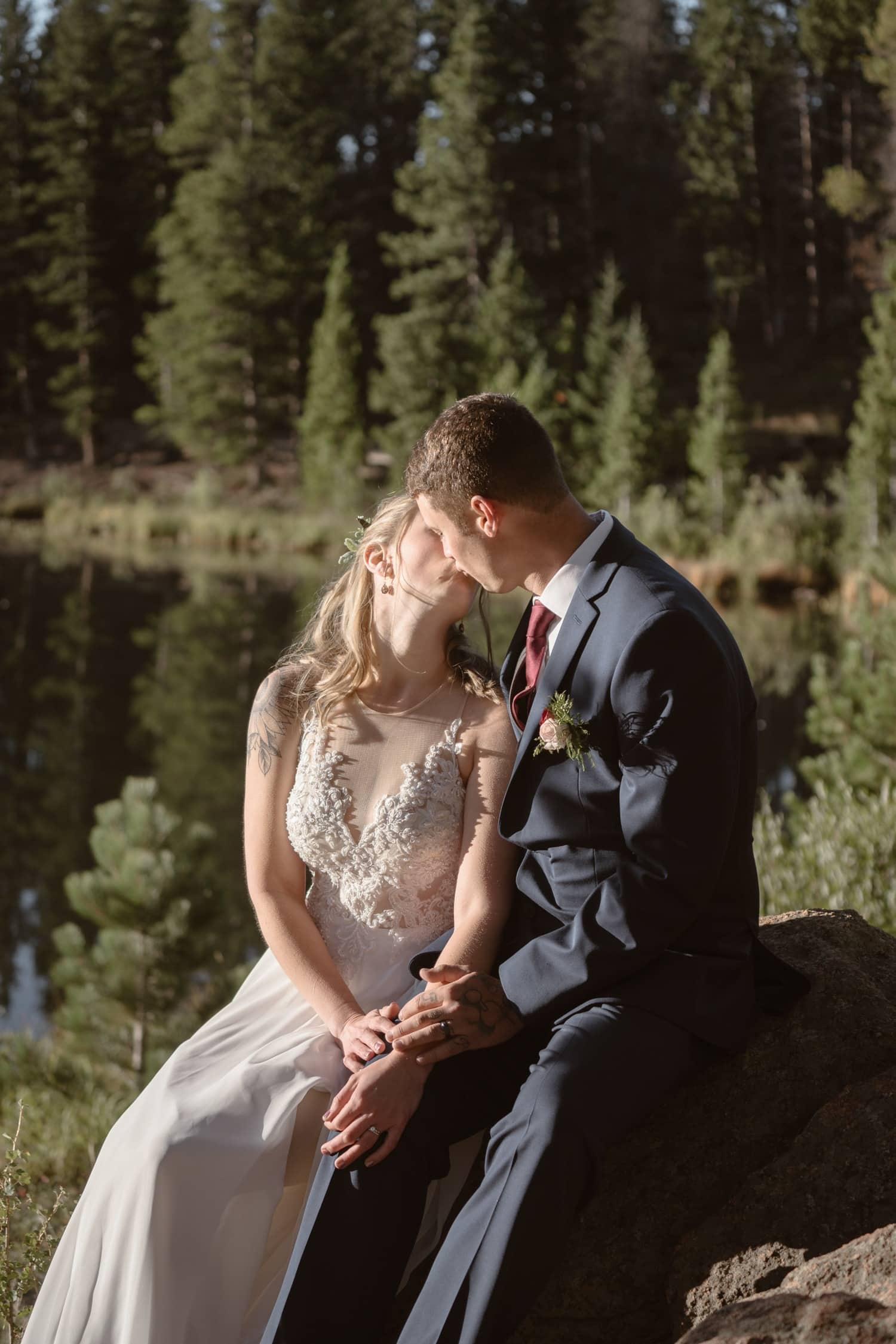 Bride and Groom kissing at Lily Lake Rocky Mountain National Park Elopement