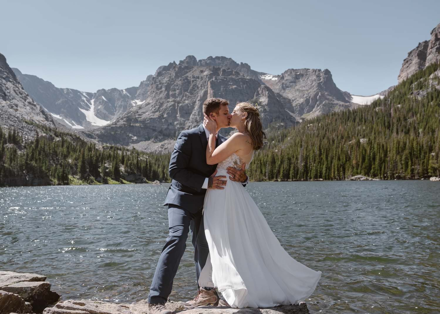 Bride and groom kissing at Loch Lake at Rocky Mountain National Park Hiking Elopement