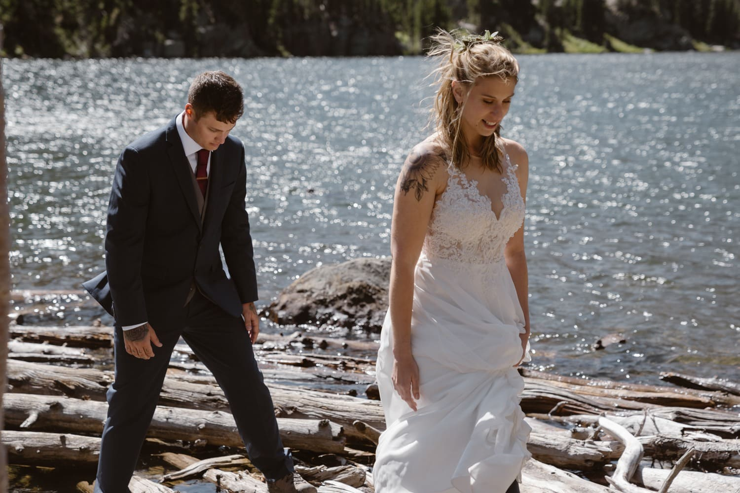 Bride and groom hiking at Loch Lake at Rocky Mountain National Park Hiking Elopement