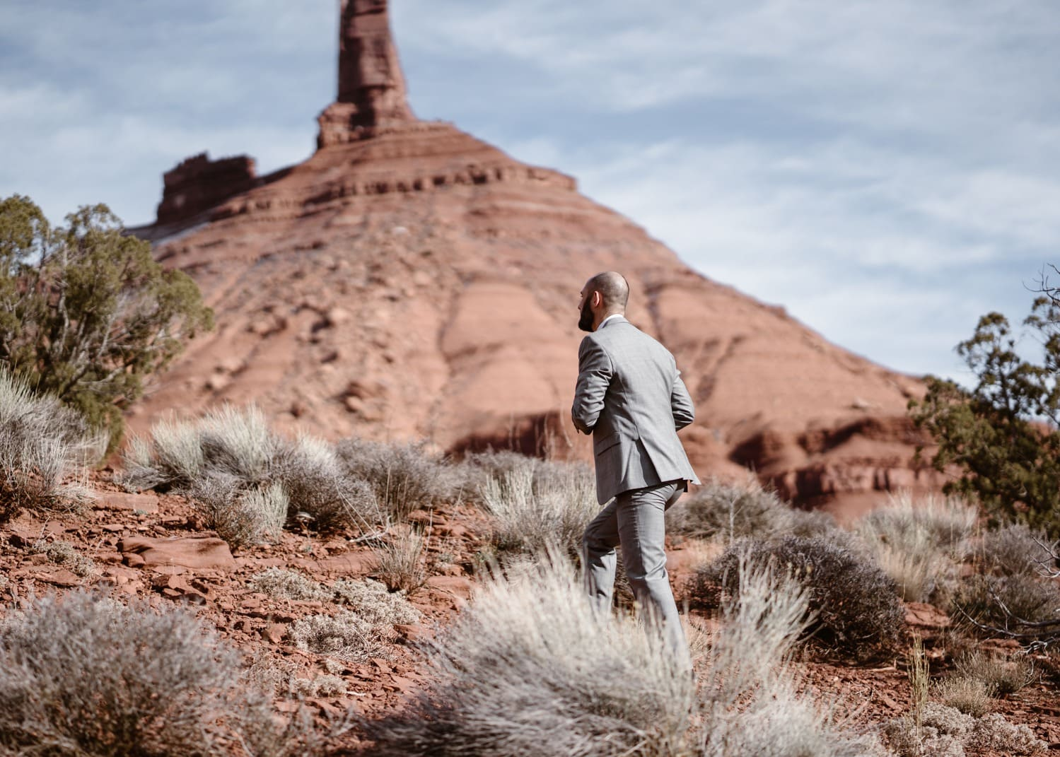 Groom Hiking During Moab Elopement