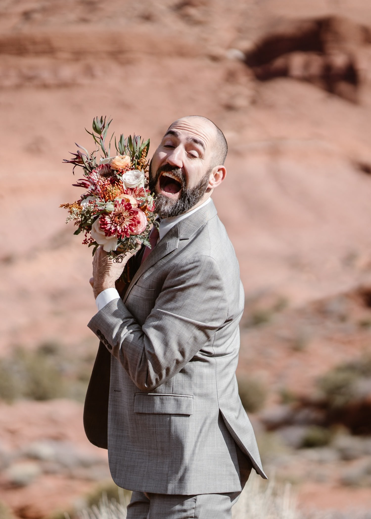 Groom With Flowers at Moab Elopement