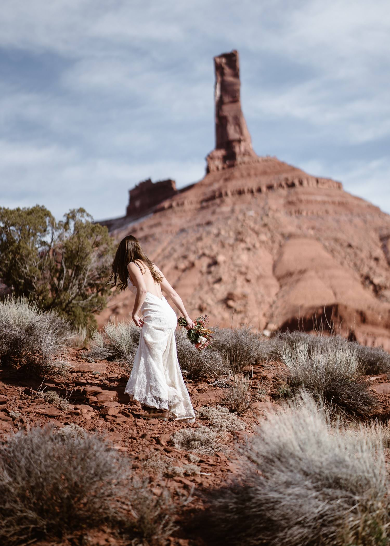 Bride Hiking During Moab Elopement