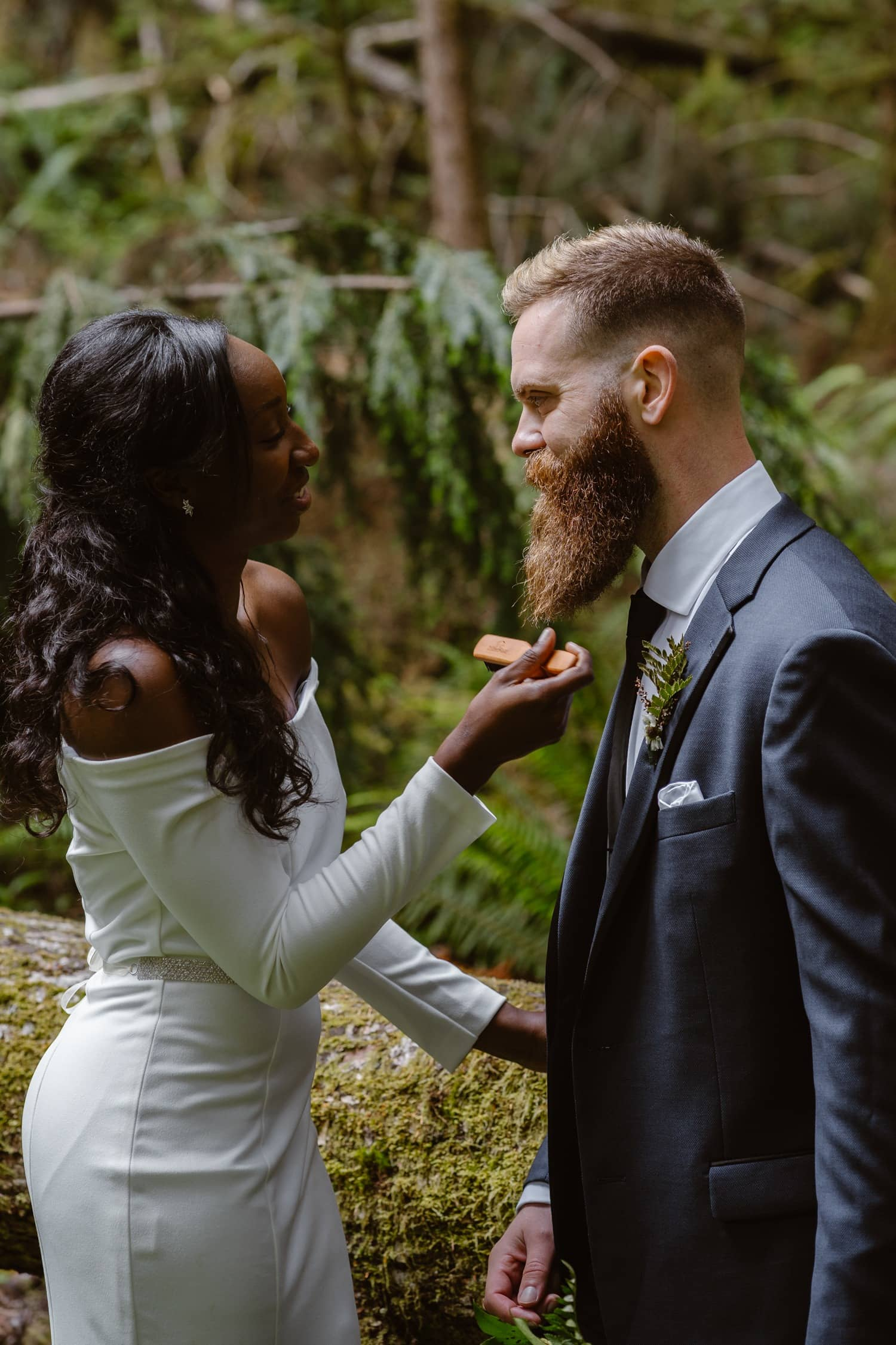 Bride grooming beard in forest at  Olympic National Park Elopement