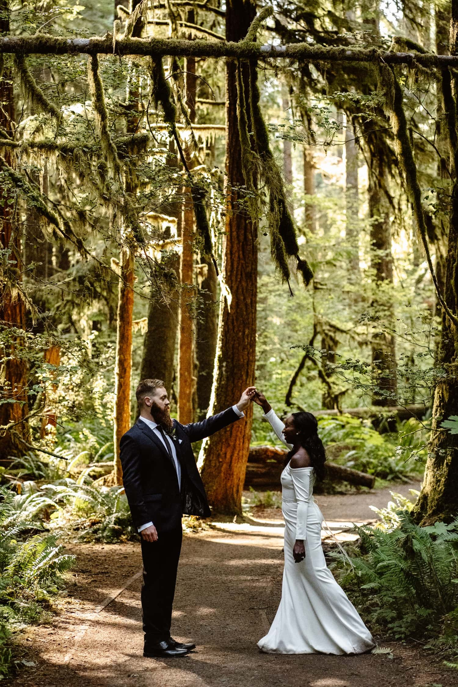 Bride and Groom dancing in forest at  Olympic National Park Elopement