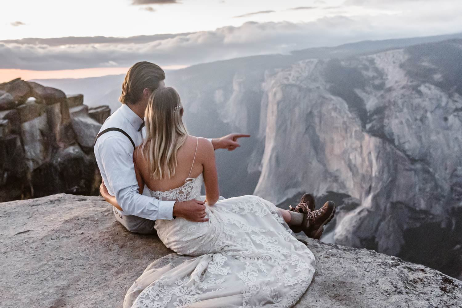 Bride and Groom Sitting at Taft Point Yosemite Elopement