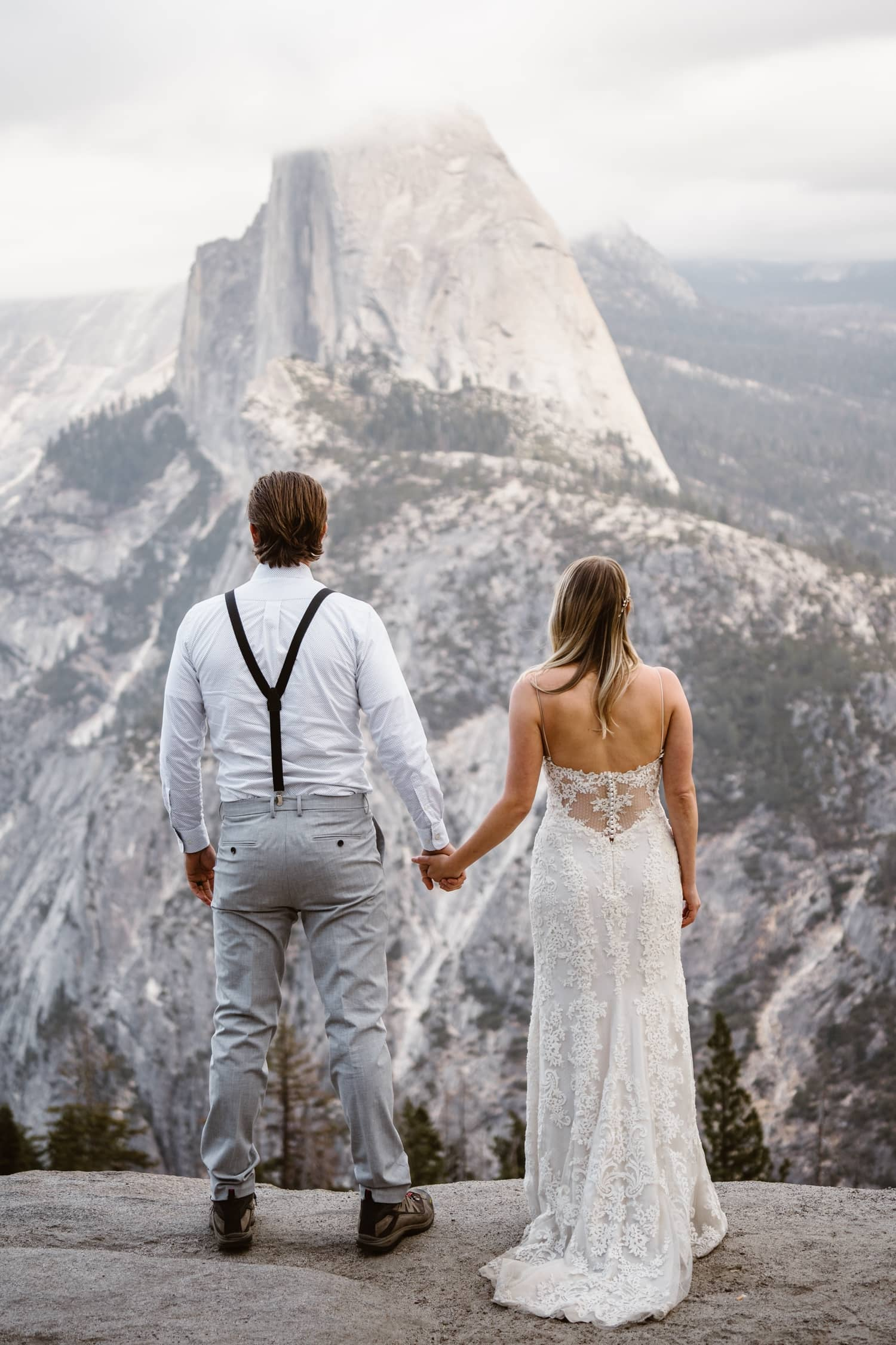 Bride and Groom Holding Hands at Glacier Point Yosemite Elopement
