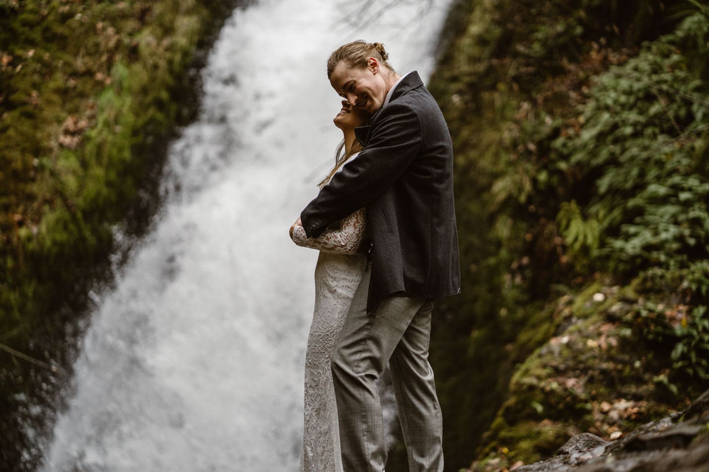 Oregon Bride and Groom Laughing at Oregon Adventurous Waterfall elopement